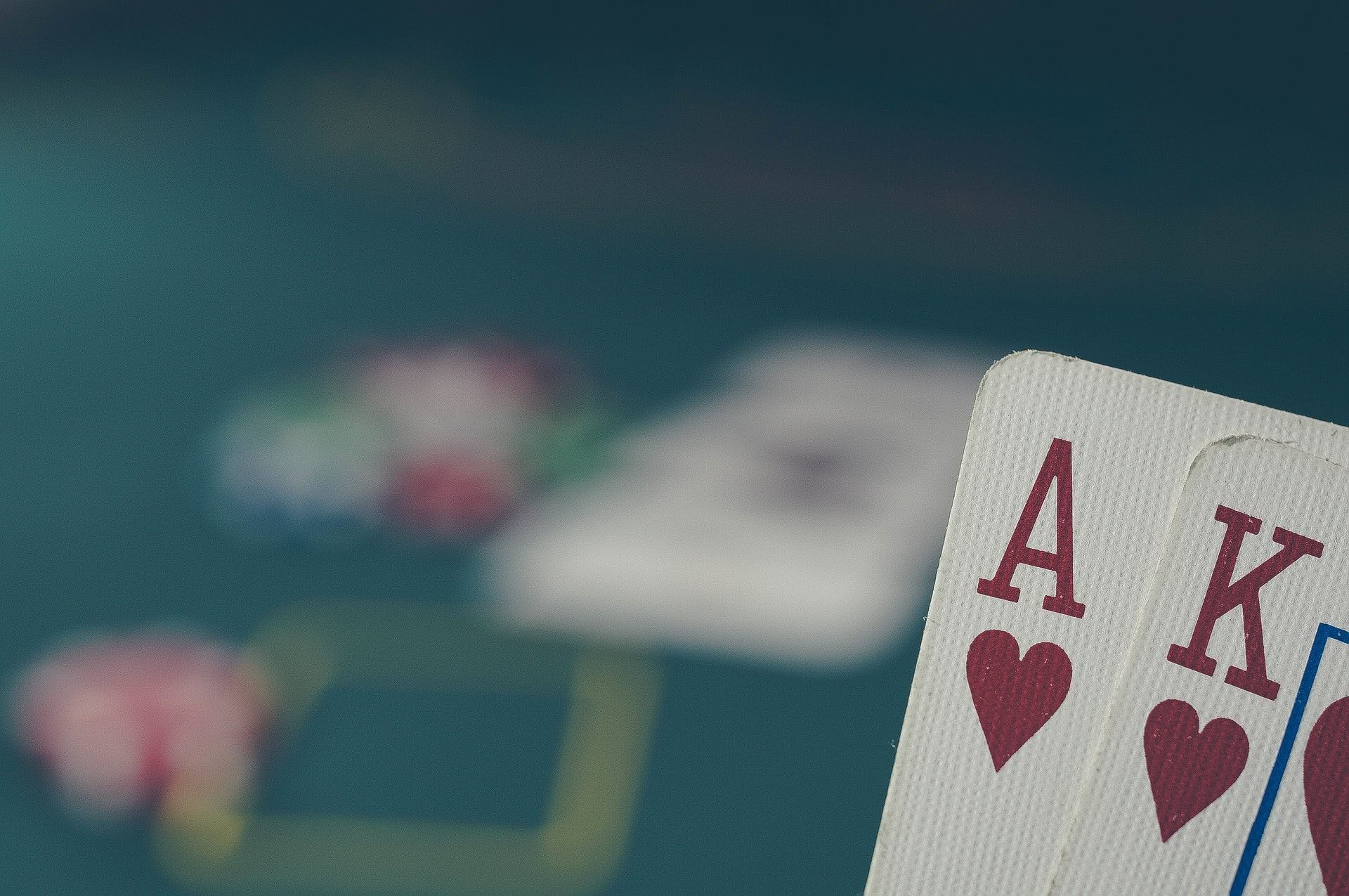 poker player holding a hand visible to the viewer